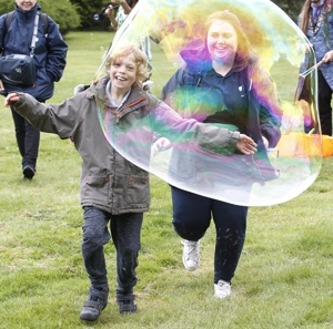 Otto in giant bubble at Let Me Shine Festival